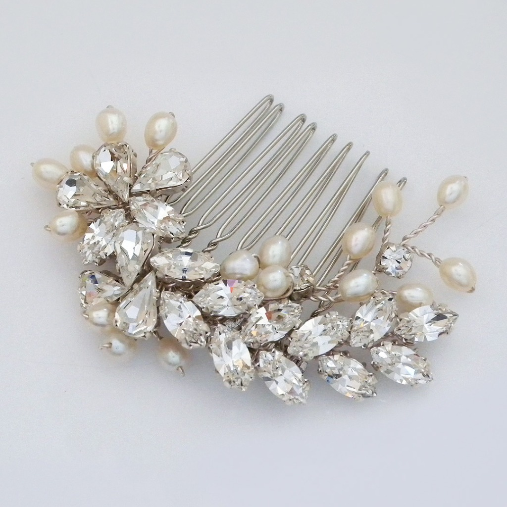 Sparkling crystals are joined by freshwater pearls on a small vine comb. Enough sparkle to be noticed, but not overdone. Designed