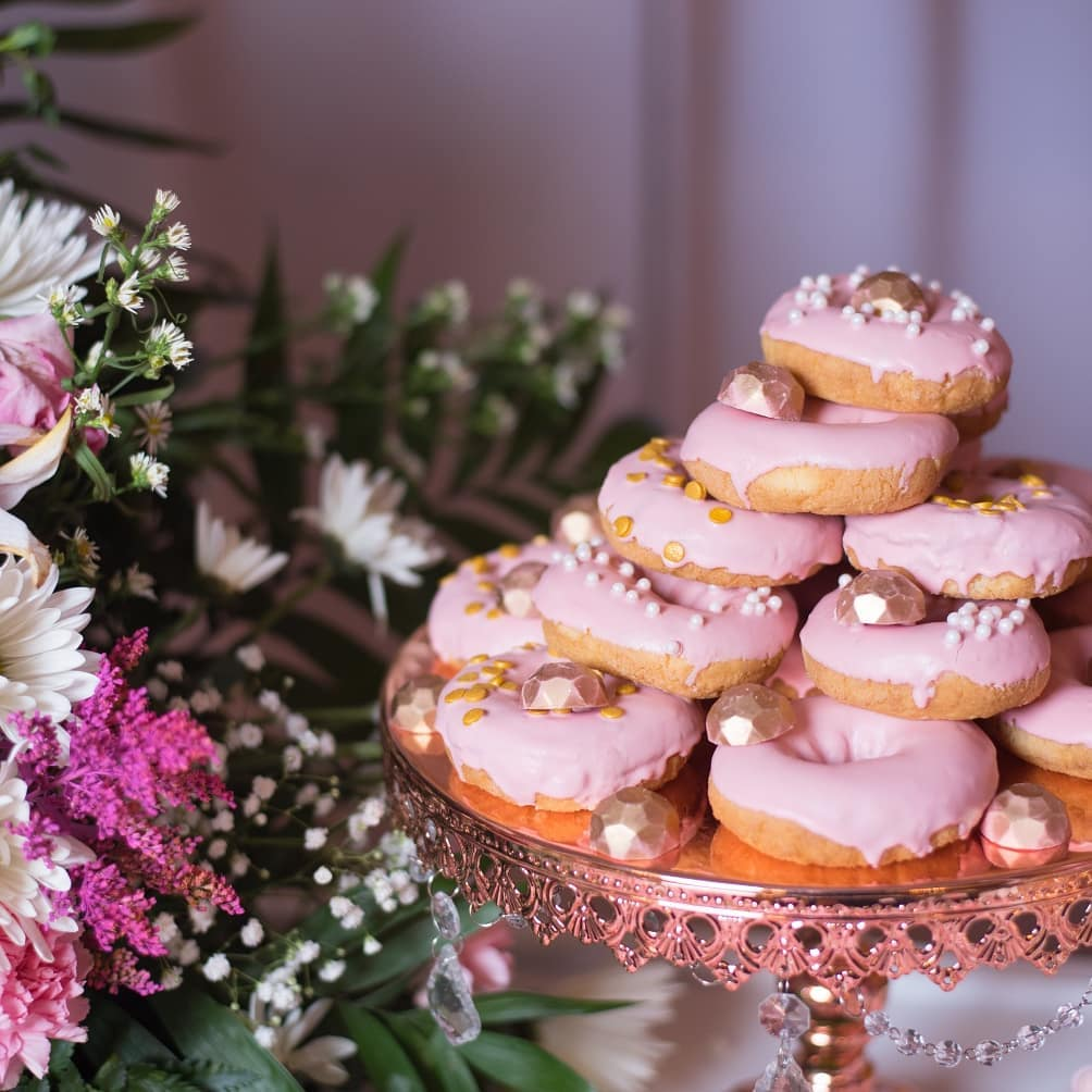 Rose Gold and Pink Donut Treats on an Opulent Treasures Rose Gold Chandelier Cake Stand ~~ Event Decor by @chyharaspartydecorations