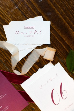 red calligraphy wedding escort cards