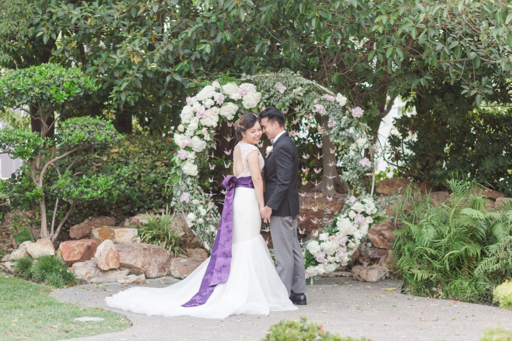 Want something different for your ceremony backdrop? What about a beautiful round floral arch with hand-folded paper cranes hanging
