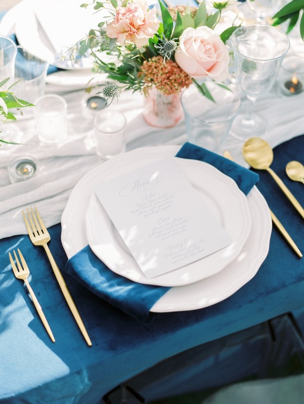 blue and gold wedding place setting