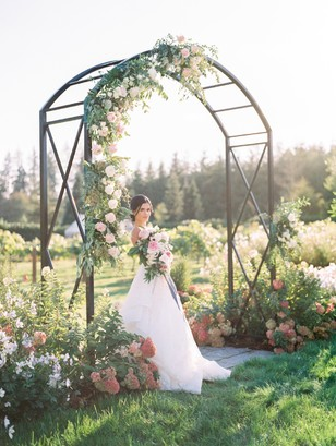 climbing floral wedding ceremony arch