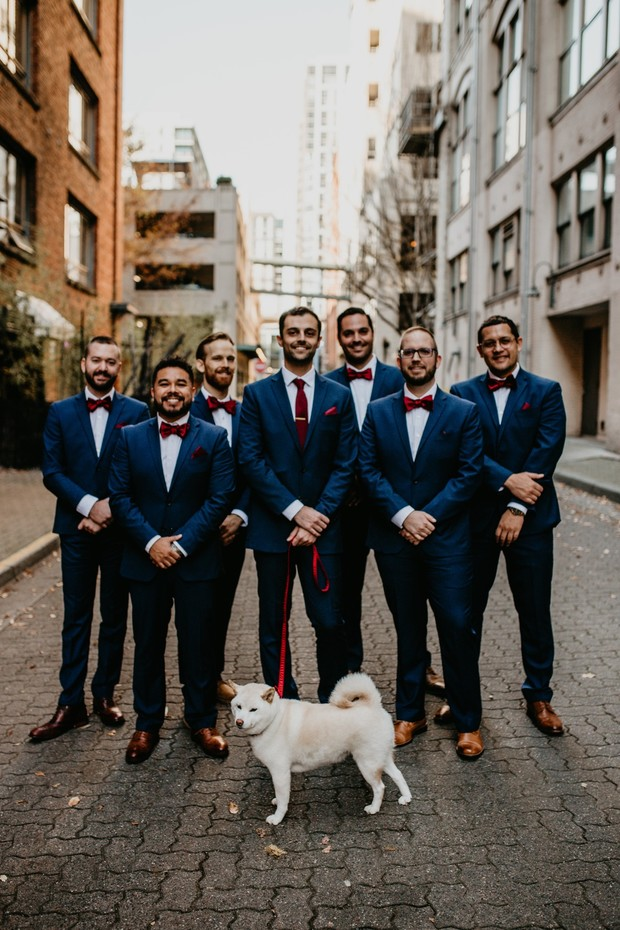 groom and his groomsmen in blue and burgundy