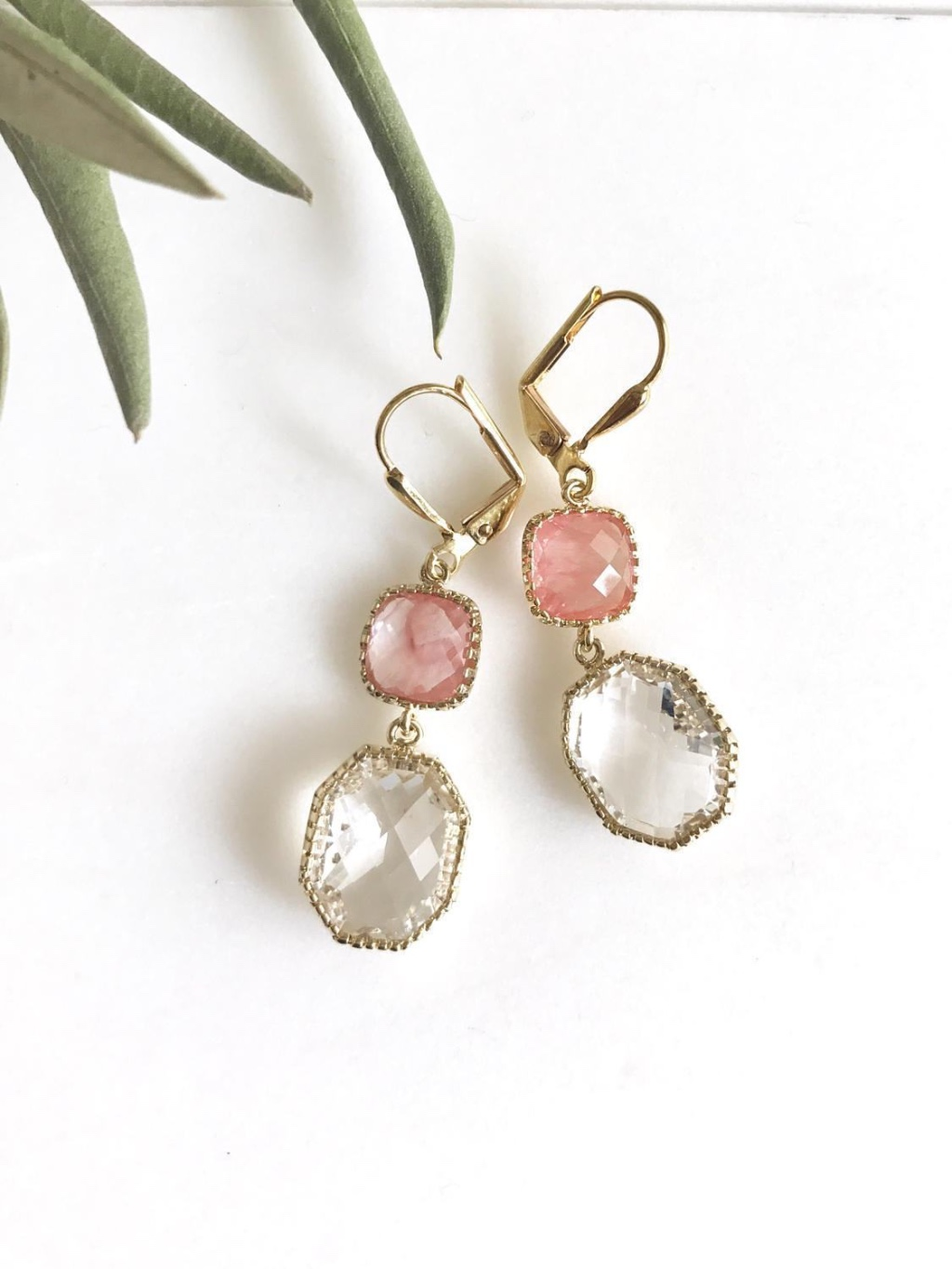 Pink and gold come together beautifully in these elegant and stunning earrings. Alive and gorgeous, these earrings will add a beautiful