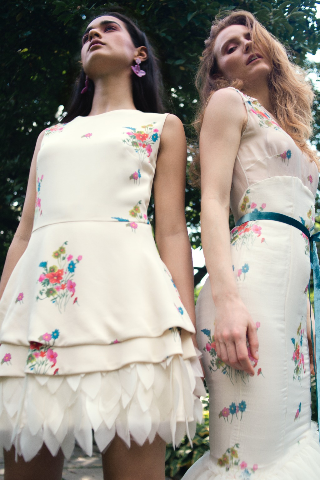 To the left is a feminine and chic silk crepe short dress featuring a beautiful custom floral print and a tiered flared skirt that
