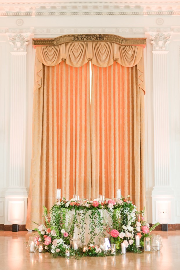 sweetheart table covered in flowers