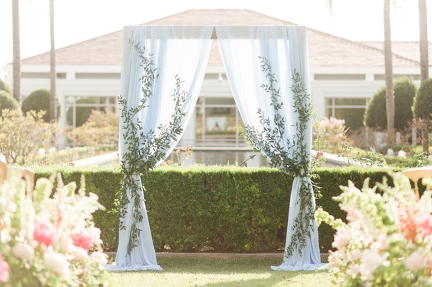 ceremony backdrop with greenery