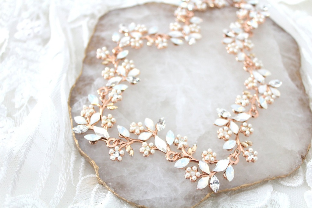 Handcrafted rose gold Swarovski Bridal hair vine with hand set Swarovski crystal and pearls. Simply stunning !!