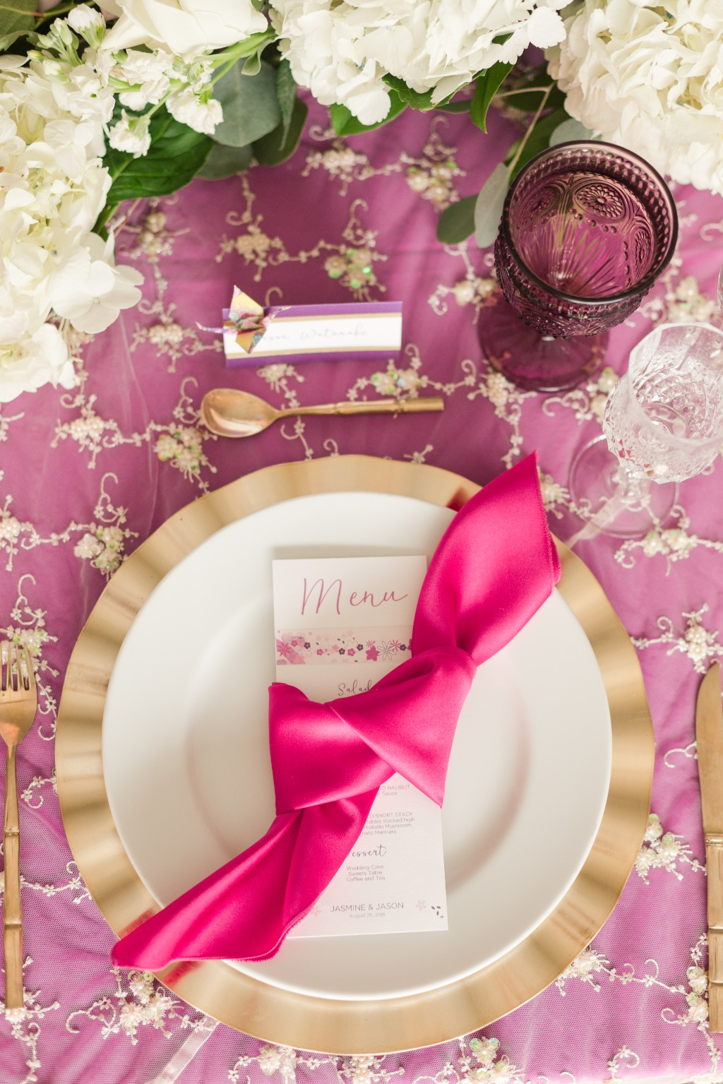 Want to add a pop of color to your tablescape? Do it with your napkins! We love this bright fuchsia napkin tied around the menu card