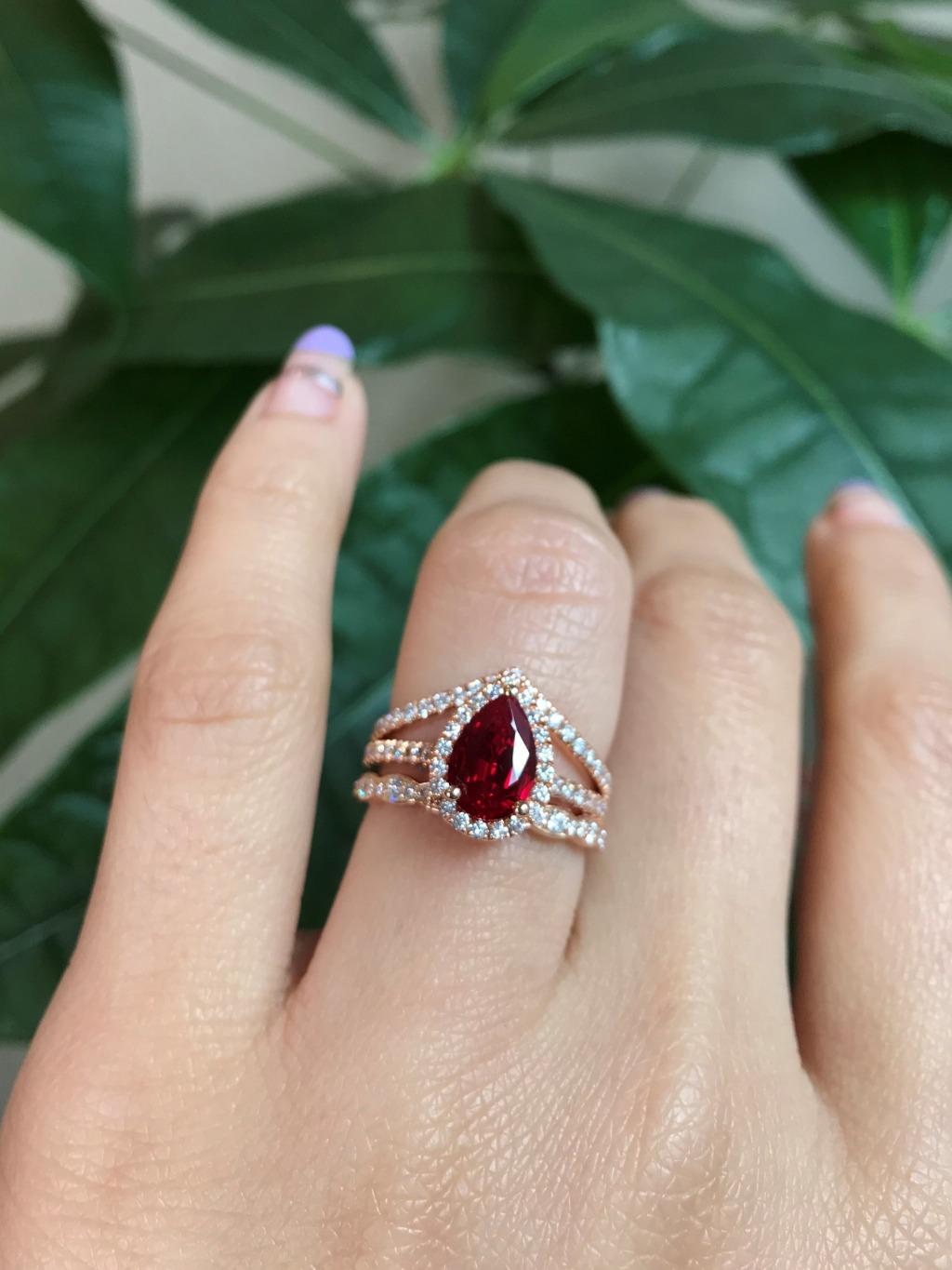 Isn't she dreamy? 😍 She is our Pear Ruby Luna Halo Bridal Set in Pave Diamond band stacked with Scalloped Diamond band with Chevron