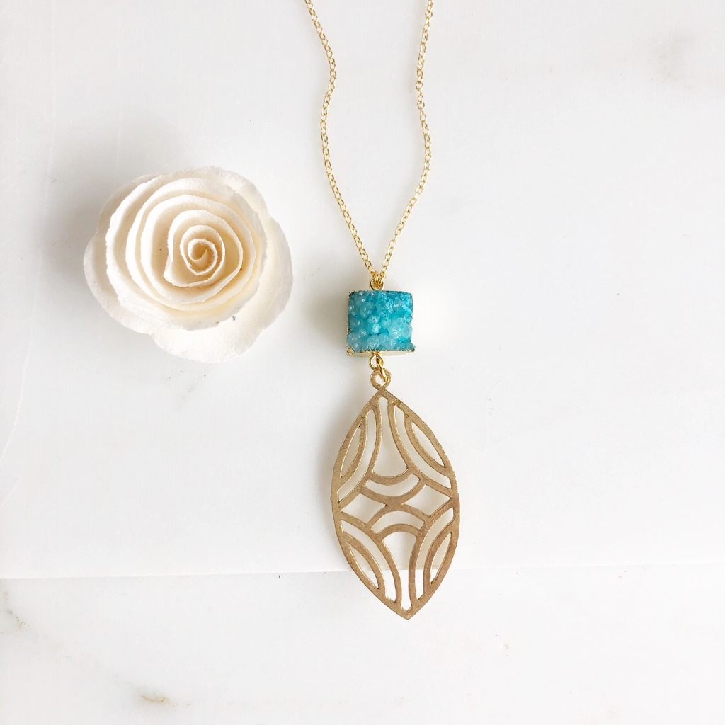 Beautiful aqua druzy with marquise gold pendant. Necklace is 30 long on 14k gold filled chain.