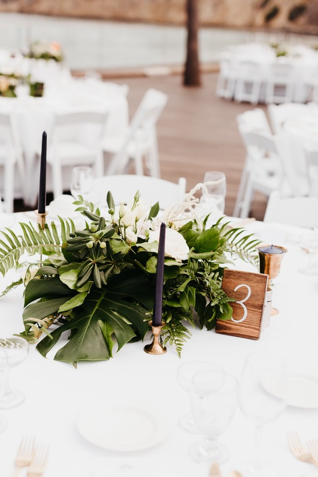 tropical greenery centerpiece for wedding