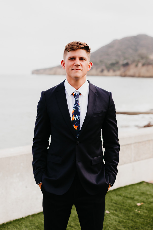 groom in a tropical tie