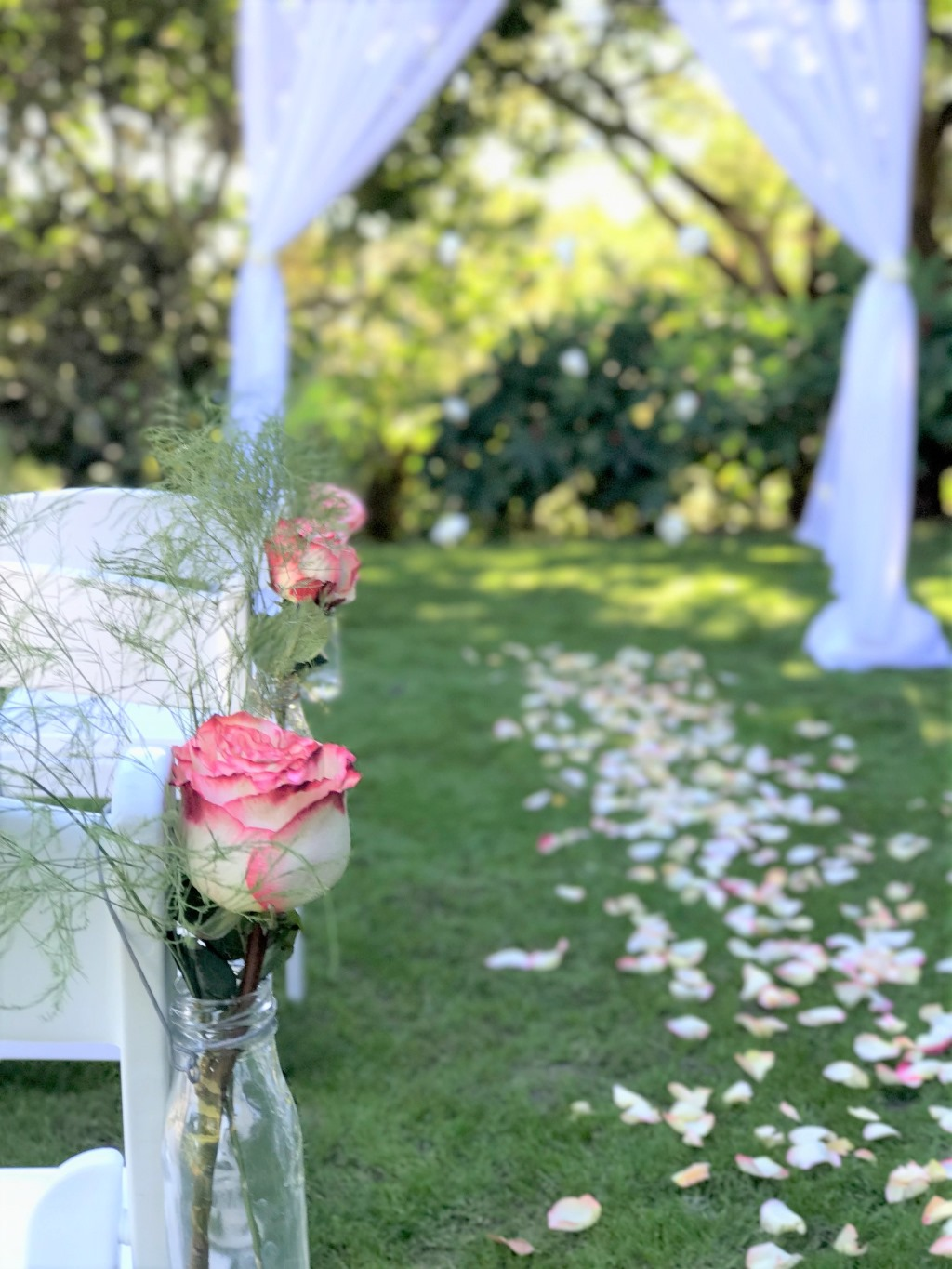 Rose petal aisle obsessed at https://www.brisbaneweddingdecorators.com.au/