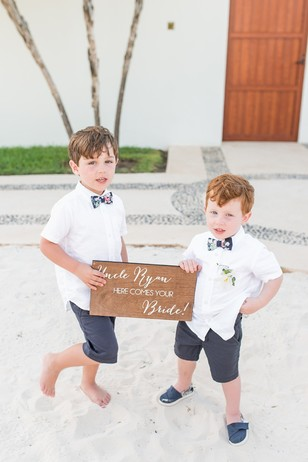 ring bearers and cute sign