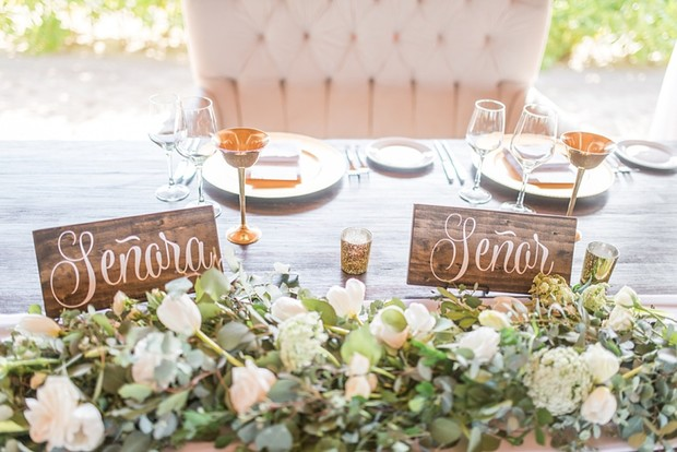 Spanish bride and groom seat signs