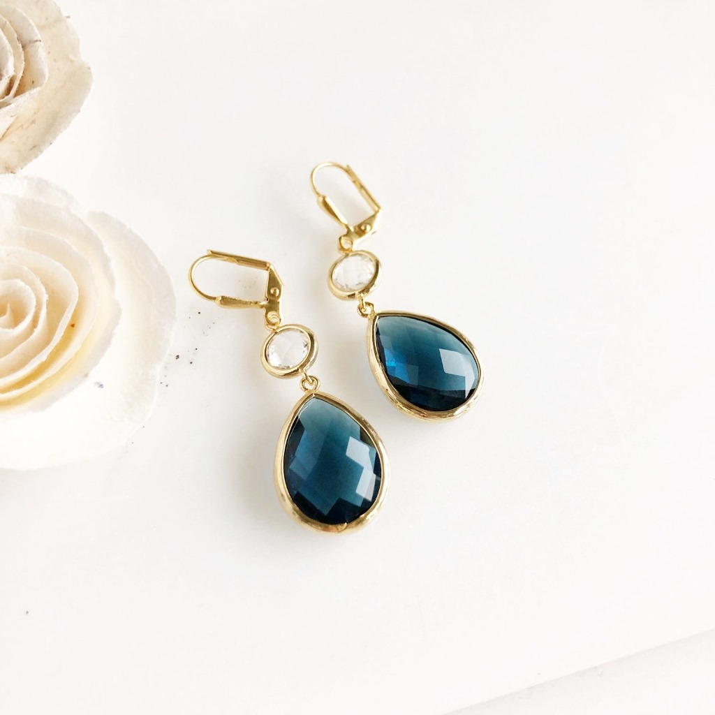 Navy blue and clear glass drop earrings. Gold plated brass earwire. Message us for bulk orders!