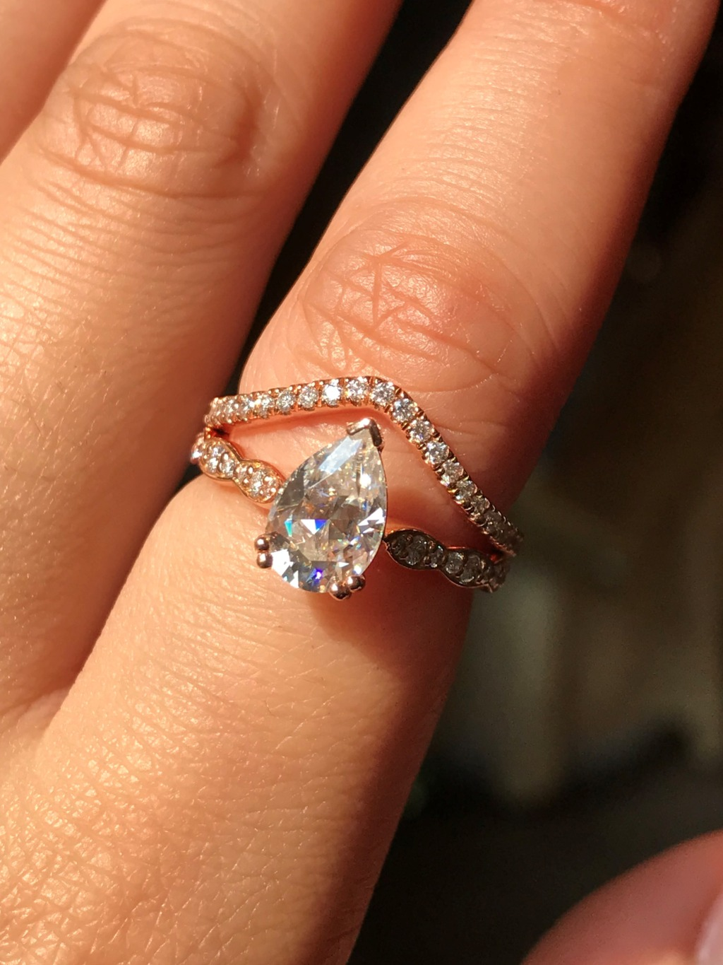For all Pear Cut lovers out there, here is our Grace Solitaire Moissanite Ring in Diamond Scalloped Band paired with our curve diamond