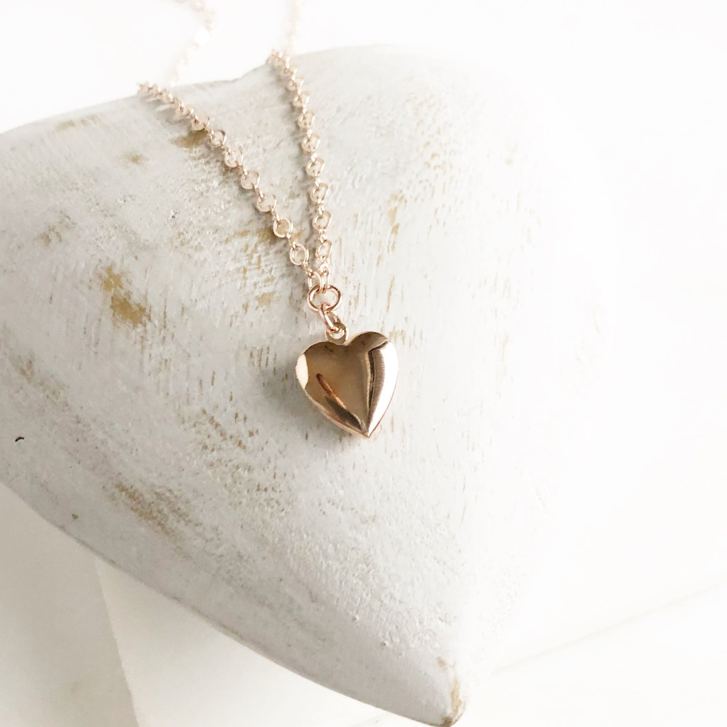 "So dainty and sweet and perfect for any occasion. The locket and chain are rose gold plated brass. The necklace is 17"" long."