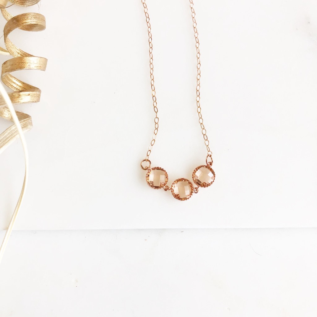 Rose gold glass pendant necklace, with round champagne stones. On 14k rose gold filled chain, 18 long.