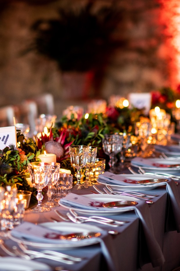 night time candle lit wedding table decor