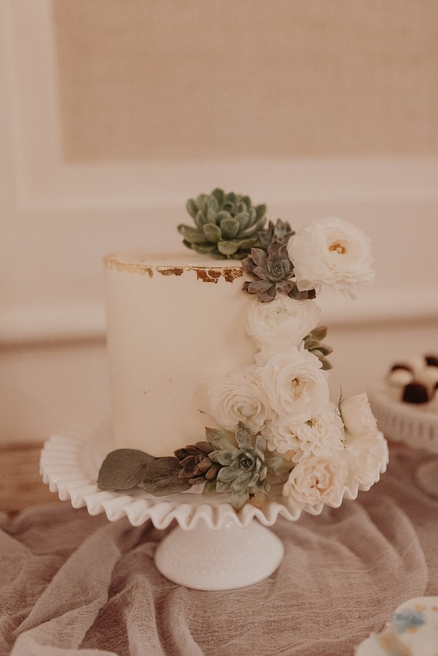 mini wedding cake with succulents