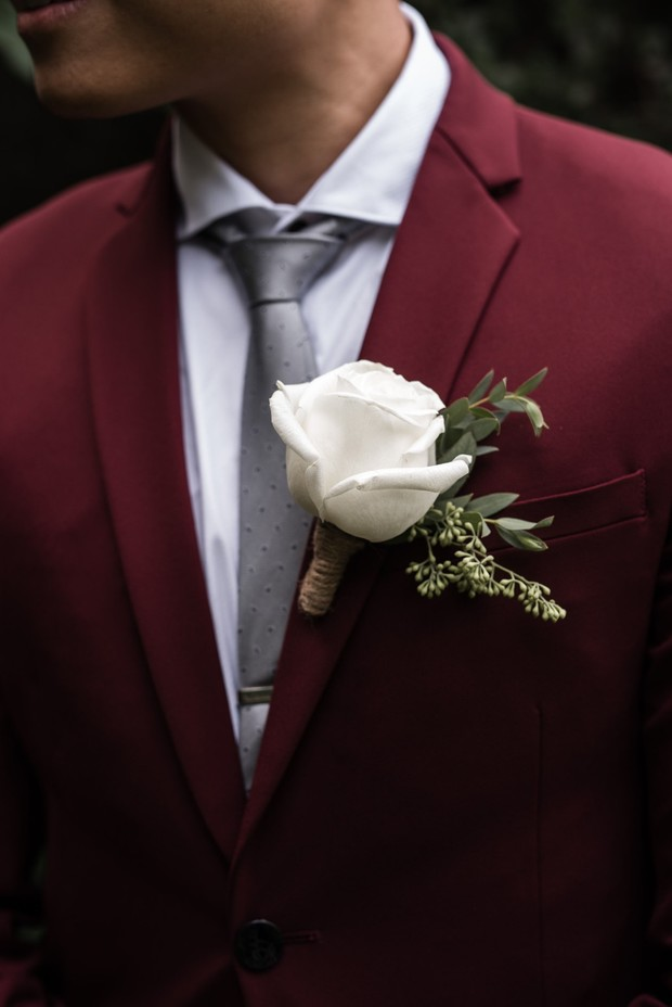 groom in a red