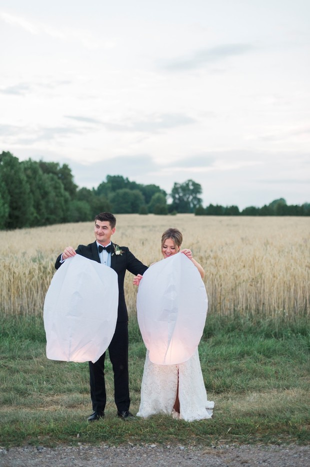 bride and groom release lanterns