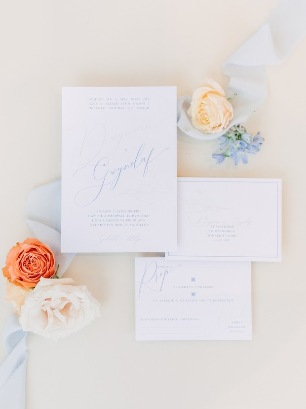 wedding invitations in blue calligraphy