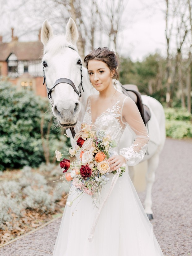 bride and white wedding horse
