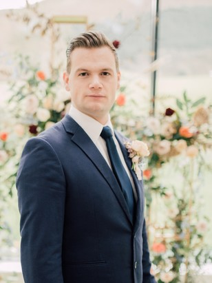 groom in classic navy blue suit