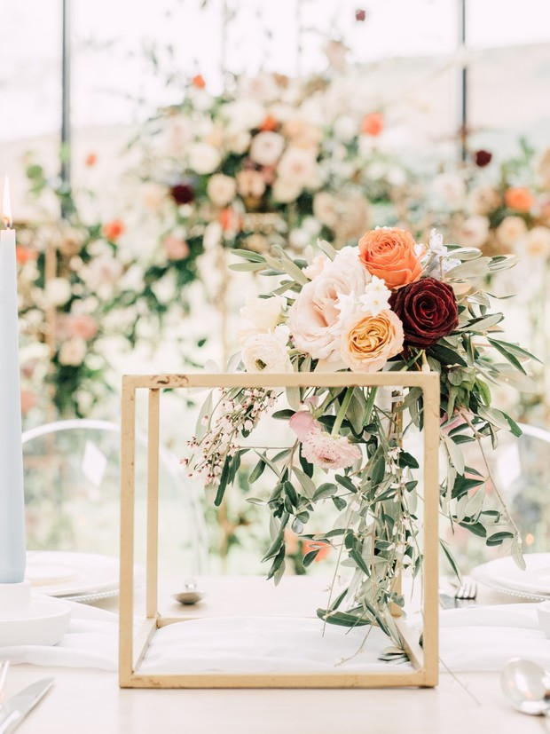 gold and floral wedding centerpiece