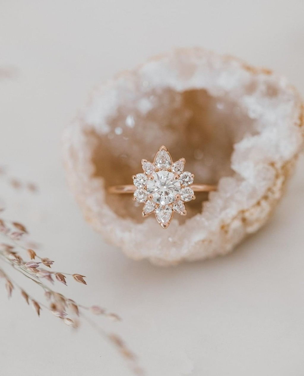 The swoon is real over our stunning Sarah O. Signature ring with a petal starburst diamond halo in 14k rose gold. Just a reminder we