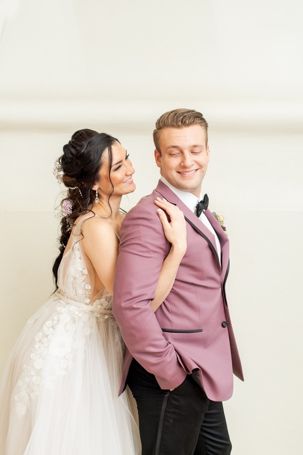 groom in mauve jacket
