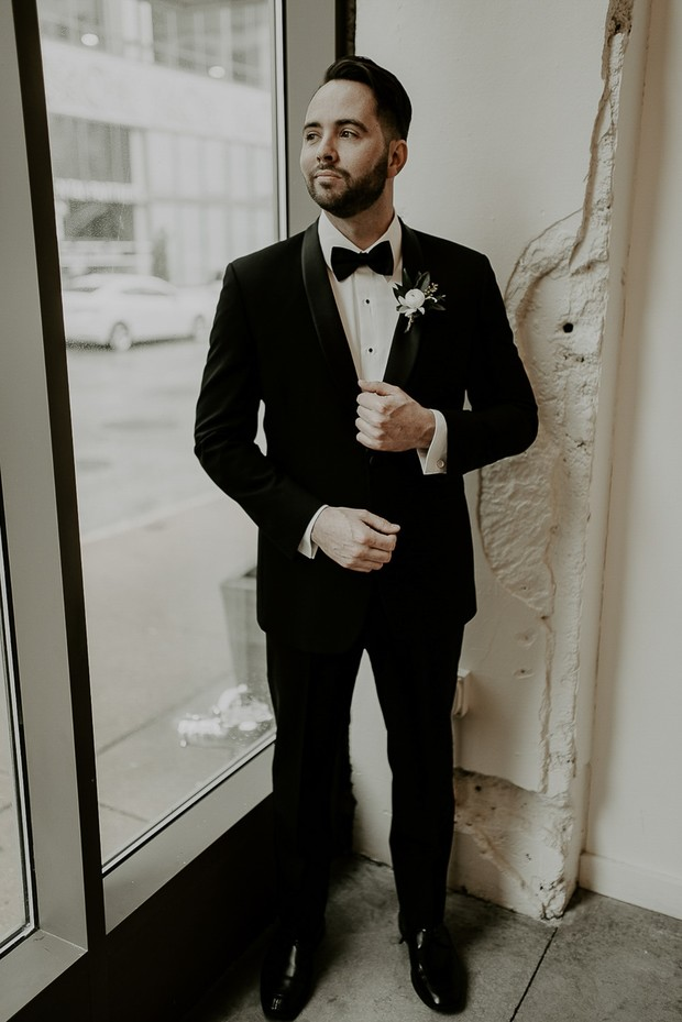 groom in classic wedding suit