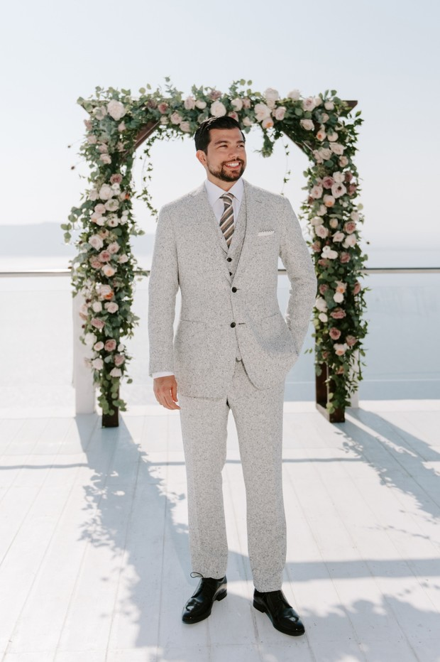 groom in grey flecked cream suit