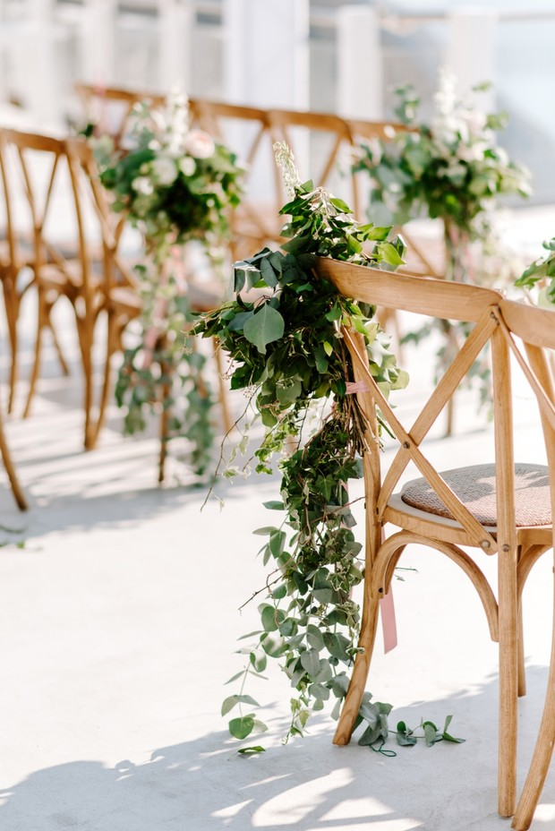 greenery draped wedding aisle