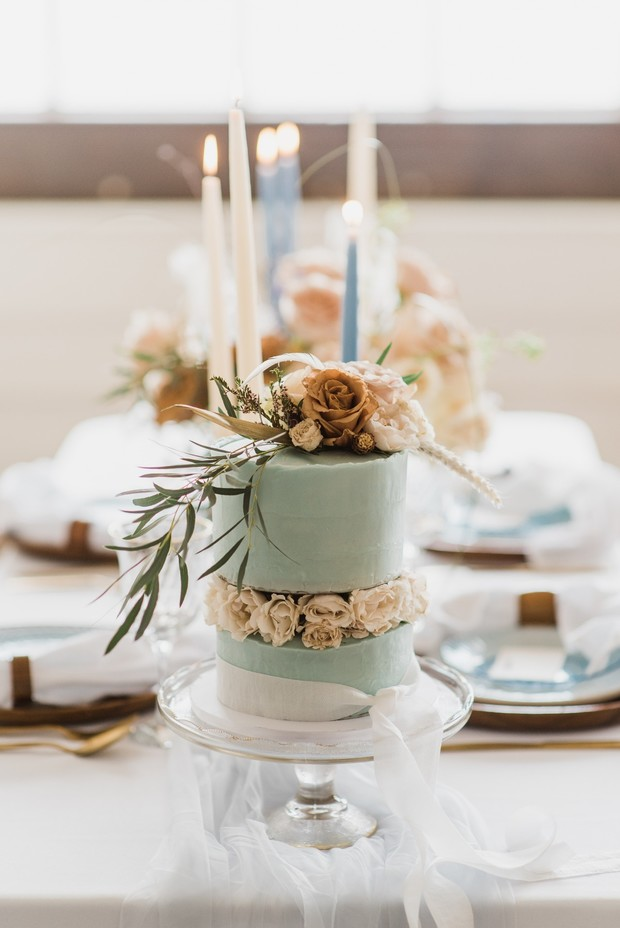 pale blue wedding cake with roses