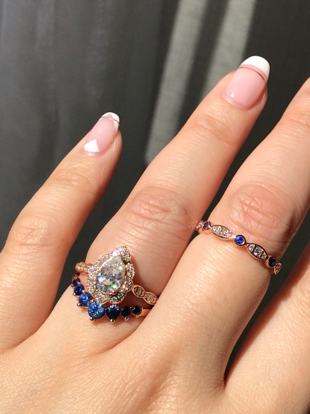 Mix and match your bridal set colors, like this Pear Moissanite Vintage Floral Ring with our Gradient Blue Sapphire 7 Stone Wedding