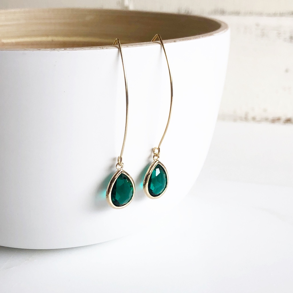 The teardrop are silver plated faceted glass and measure 16mm x 11mm. The earrings dangle about 2.25 inches and the earwires are silver