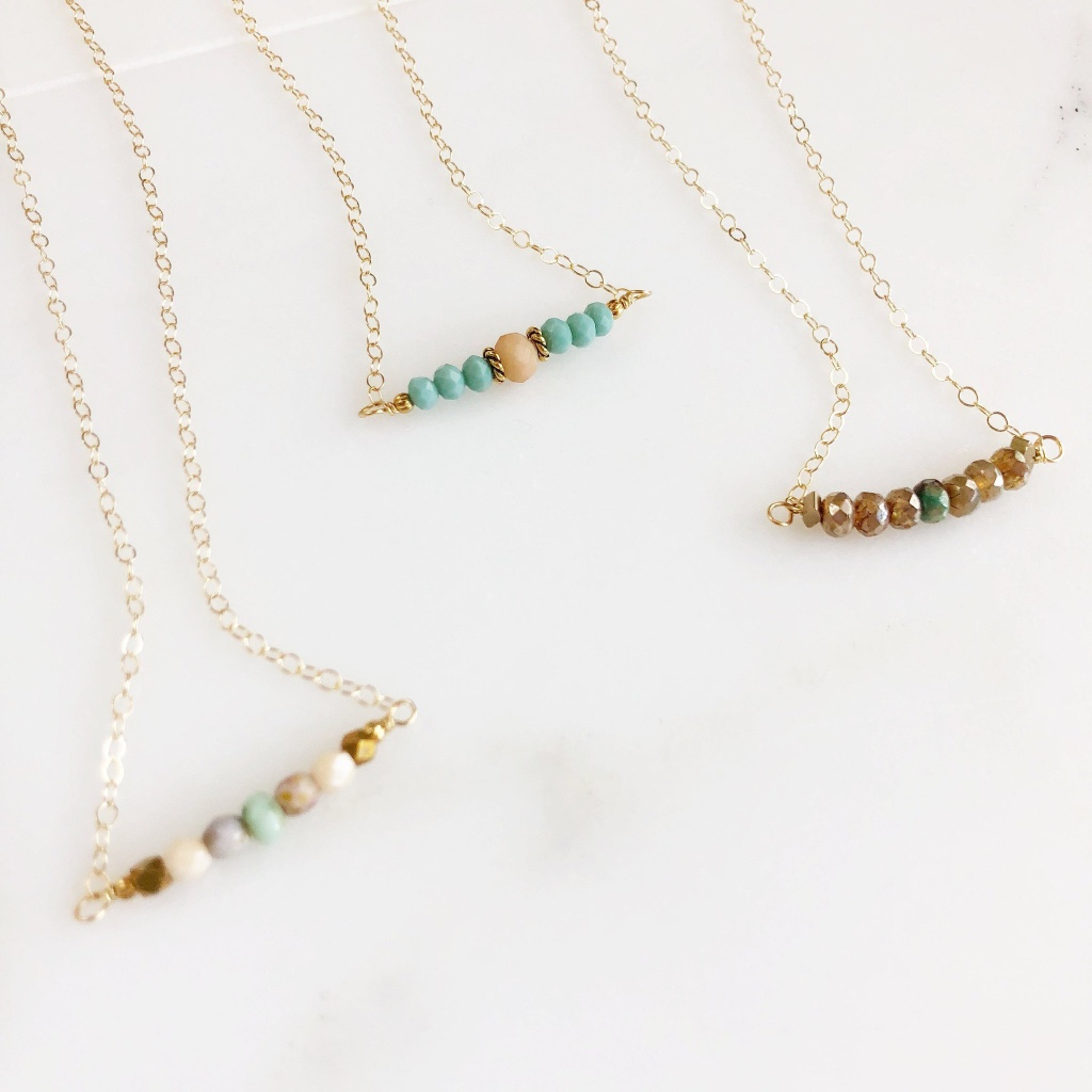 The stones are glass, and 6mm and the necklace is about 17 long on a delicate 14k gold filled chain.