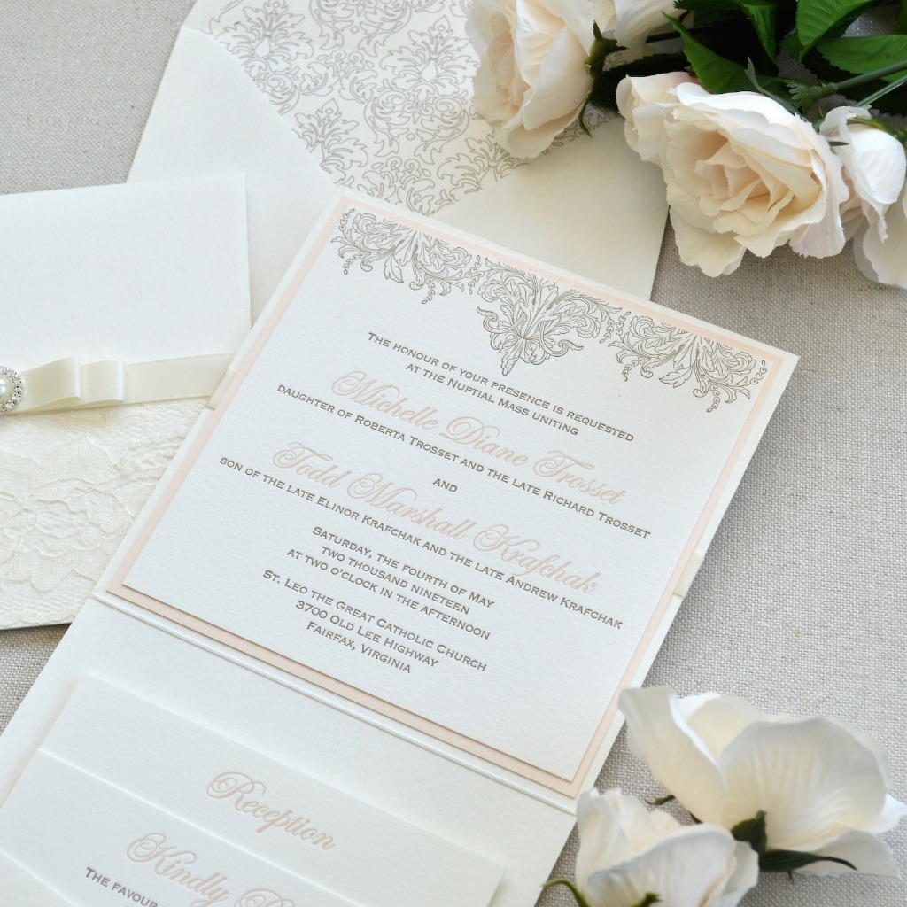 Letterpress printing is so timeless. There's so many layers of romance in these invitations, with pockets, sash, broach and delicate