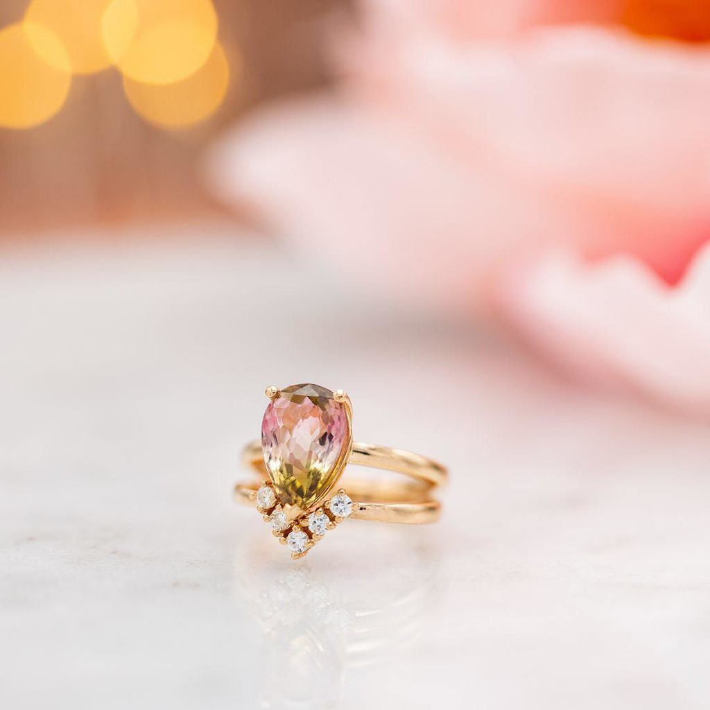 This stunning, juicy slice of watermelon tourmaline is the star of the show in this ring set. Designed for the woman who studied geology