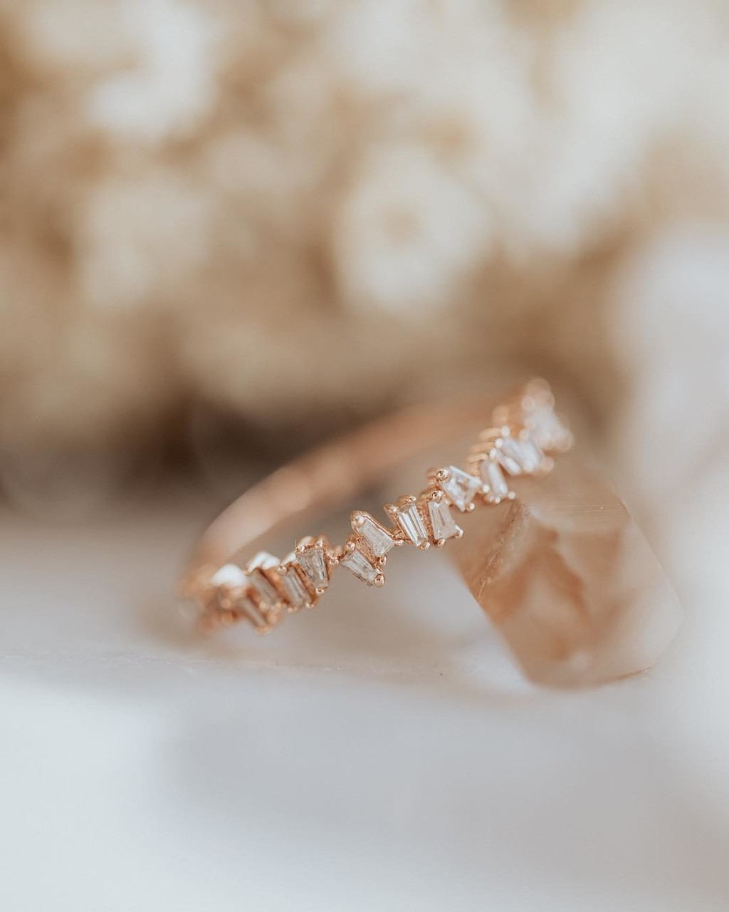 We love this scattered baguette band in 14k rose gold! Available online & in store now.