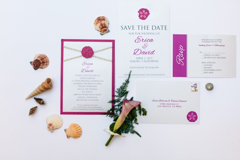 This beach-inspired invitation suite featured string pearls and beautiful cut outs of sand dollars and shells, to add a touch of the