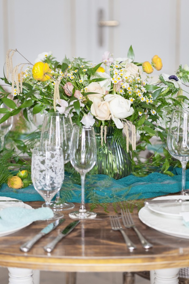 yellow and teal wedding table decor