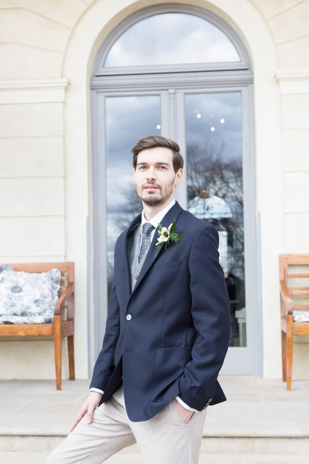 groom in navy suit jacket and sand colored trousers