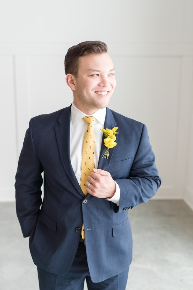 groom in navy and yellow
