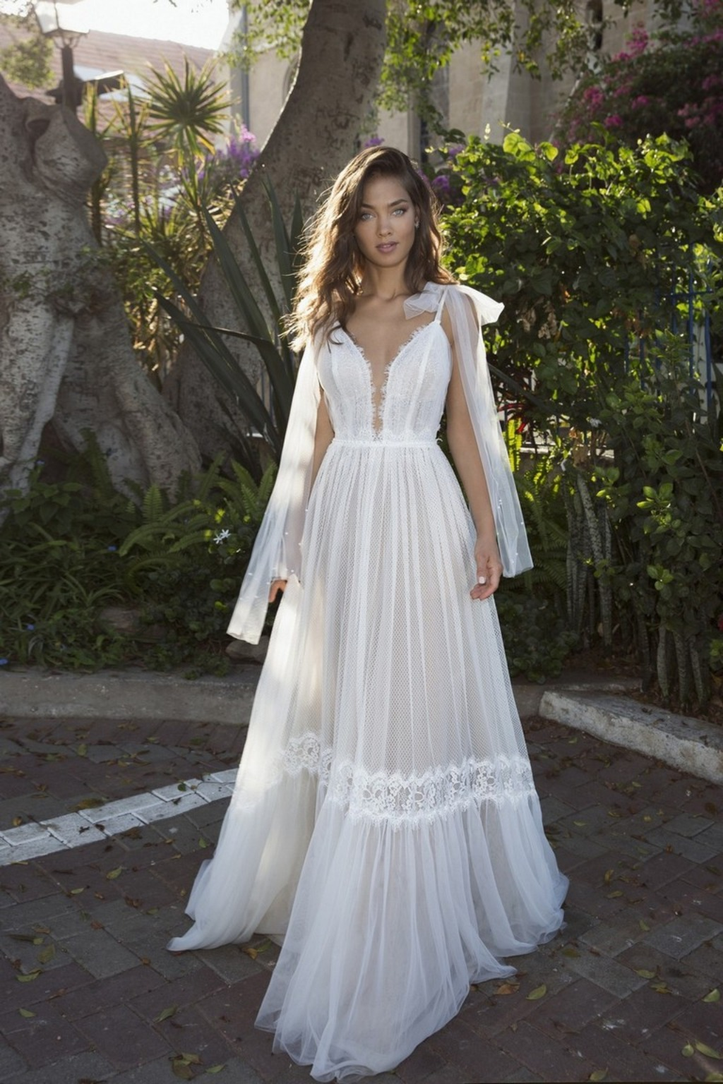 This gorgeous wedding dress is available at Diamond Bridal Gallery.