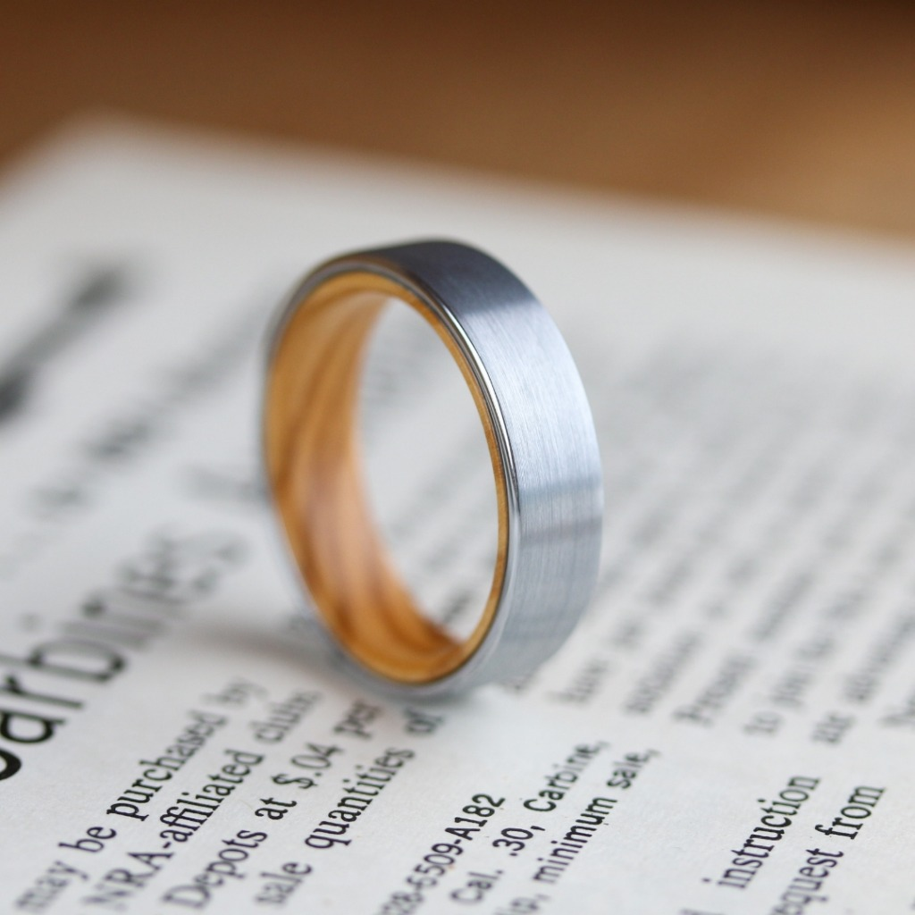 Men's tungsten wooden wedding ring. Brushed silver textured top with an olive wood interior. Super durable and super comfy. The ultra